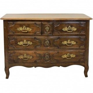 A LOUIS XV WALNUT & ORMOLU MOUNTED COMMODE