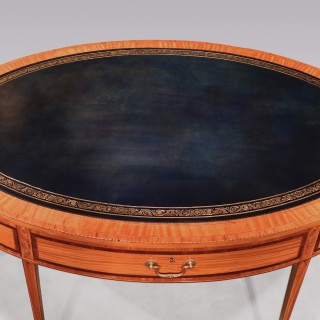 A Fine Mid 19th Century Satinwood Oval Writing Table