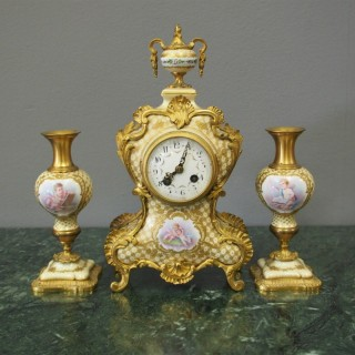 French Painted Porcelain Clock Garniture