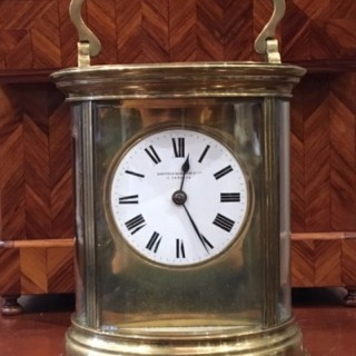 Large Oval Striking Carriage Clock By Richard & Co Paris