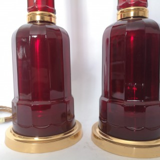 Pair of early 20th century red glass and gilt bronze lamps