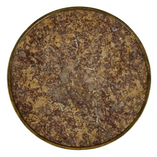 Gilt bronze mounted mahogany round table by Henry Dasson
