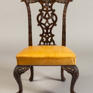 An Excellent Long Set of Carved Mahogany Dining Chairs