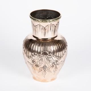 A copper Art Nouveau Repoussé vase
