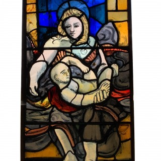 A Stained Glass Window Depicting Madonna And Child