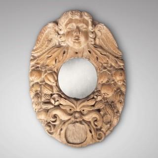 Carving surmounted by cherub's head