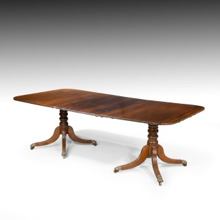 A George III Period Mahogany Two Pillar Dining Table