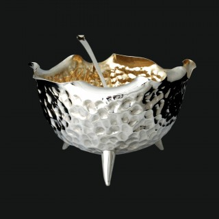 An aesthetic silver punch bowl and spoon by Hukin and Heath for Leuchars