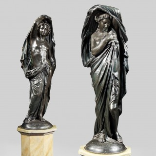 A Dramatic & Highly Decorative Pair of Statues in the Classical Manner
