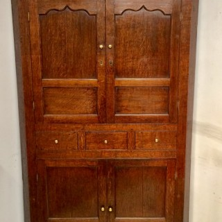 Welsh oak double corner cupboard.