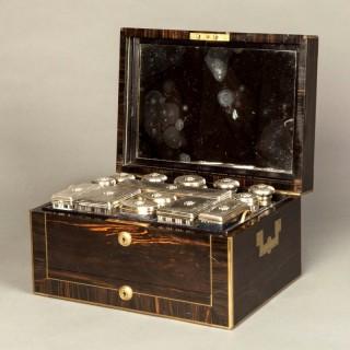 A Victorian coromandel and brass bound dressing case by Asprey