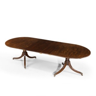 A Regency Period Two Pillar Dining Table of Oval Shape