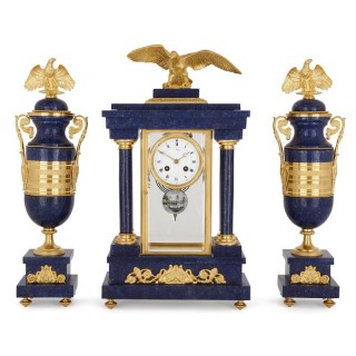 French Empire style lapis and gilt bronze three-piece clock set