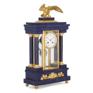 French Empire style lapis and gilt bronze three-piece clock set