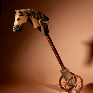 A Toy Hobby Horse Stick Horse Equestrian On wheels Continental Circa 1900-20.