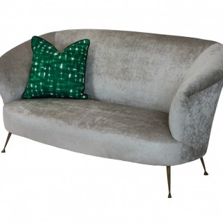 A CURVED MID CENTURY SOFA