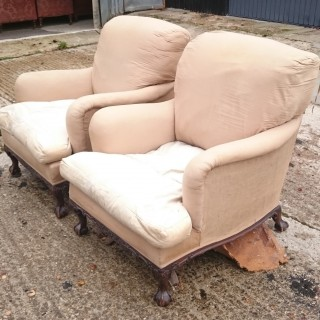 Pair of Comfortable Armchairs by Howard and Sons of London
