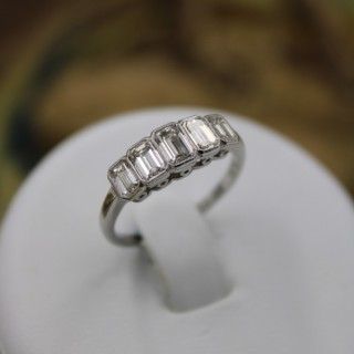 A very beautiful Platinum  Graduated Five stone, Emerald Cut, Diamond Ring, Pre-owned
