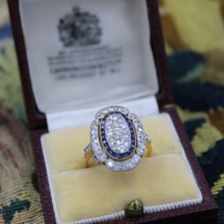 A fine 18 Carat & Platinum Elongated Oval Diamond & Sapphire Ring, French Circa 1925