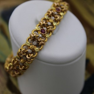 A very fine 18 Carat Green, Yellow and Pink Gold (French marked) Ruby set bracelet.