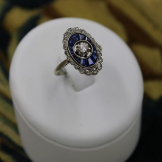A very fine 18ct Yellow Gold & Platinum Art Deco Diamond and Sapphire ring in an oval floating setting, Circa 1930