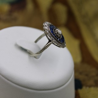 A very fine 18 Ct. Yellow Gold & Platinum Art Deco Diamond and Sapphire ring in an oval floating setting, Circa 1930