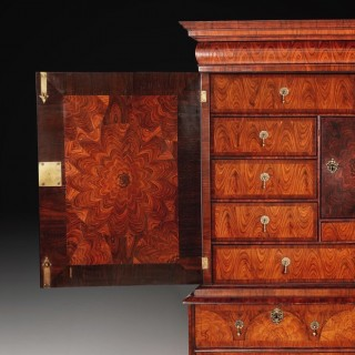 William and Mary Kingwood or 'Princes' wood oyster cabinet on chest