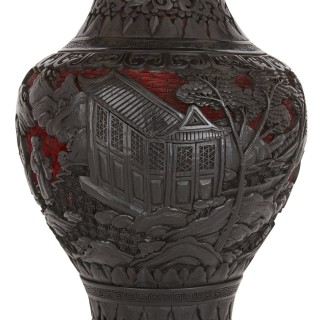 Pair of Chinese Qing period black and cinnabar red lacquered vases