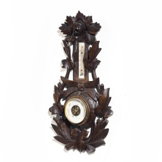 A Late 19th Century Black Forest Barometer and Thermometer