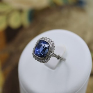 A exquisite Platinum 8.10ct Natural Untreated Ceylon Sapphire & Diamond Cluster Ring, Circa 1925