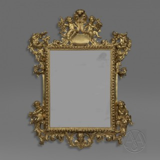 A Fine North Italian Baroque Revival Carved Giltwood Mirror Allegorical of The Seasons