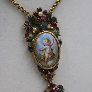 High Carat Yellow Gold Oval Enamel Cherub, with Sapphire, Ruby, Pearl and Green Enamel Flowers, Circa 1870