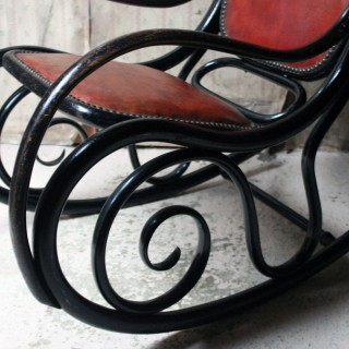 An Ebonised Thonet Style Bentwood & Leather Upholstered Rocking Chair c.1910