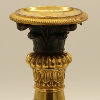 Pair of early 19th Century bronze & ormolu Candlesticks