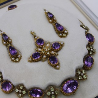 An exceptional example of a  late Georgian Demi-Parure in High Carat Yellow Gold set with Amethysts, Seed Pearls and Chrysoberyl, Circa 1820.
