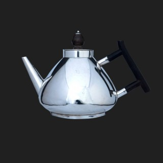 A Christopher Dresser sterling silver aesthetic tea set