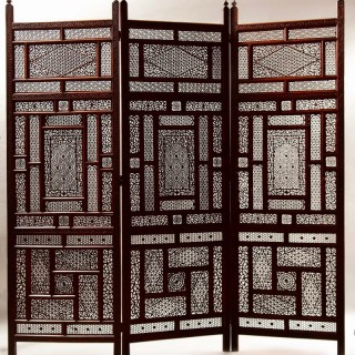 A Very Fine Carved Hardwood Anglo Indian Folding screen Circa 1900.
