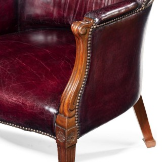 A pair of barrel-backed Mahogany wing arm chairs