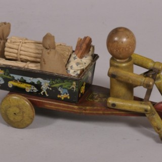 Antique Early 20th Century American Wood and Litho Decorated Tin Pull Toy