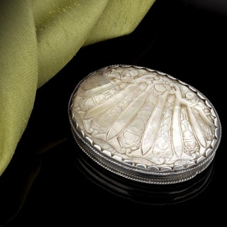 A little carved mother of pearl box with silver mounts, 17th Century