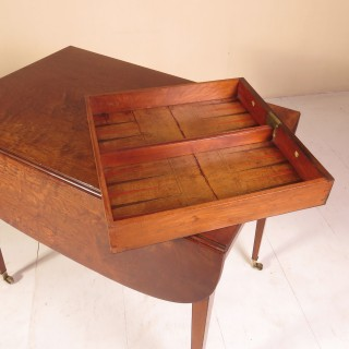 A Sheraton Period Mahogany Pembroke / Games Table
