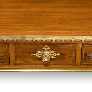 An Unusual Late Regency Mahogany Three-Drawer Side Table.