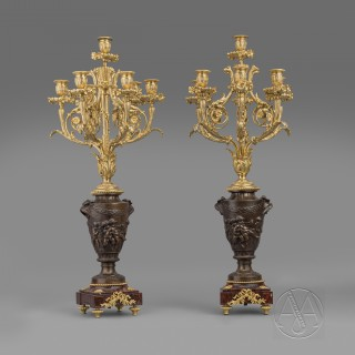 A Fine Pair of Gilt and Patinated Bronze Seven-Light Candelabra After A Design By Clodion Cast by Suse Frères