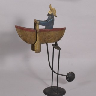 Antique Early 20th Century Folk Art Painted Tin Sailor Rowing a Boat