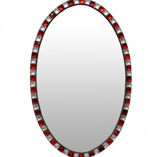 AN IRISH MIRROR WITH ROCK CRYSTAL & RUBY GLASS STUDDED BORDER