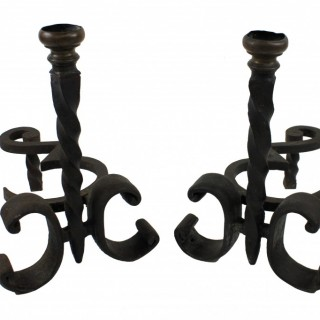 A PAIR OF WROUGHT IRON CHENET