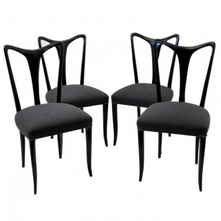 A SET OF FOUR ULRICH DINING CHAIRS