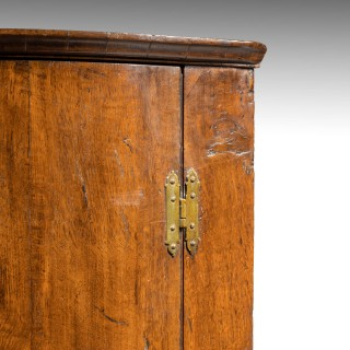 A George III Period Oak Corner Cupboard