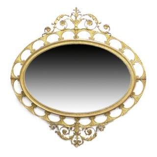 19th century Adam style carved giltwood oval mirror.