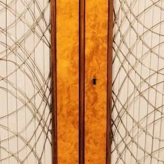 A Regency amboyna breakfront side cabinet
